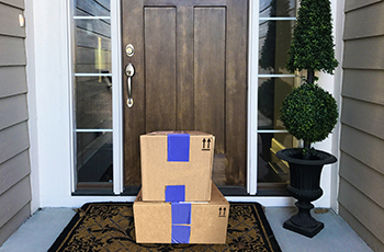 Packages sitting on front doorstep outside