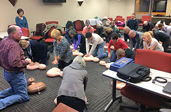 Plymouth residents learning CPR at a Heart Safe Plymouth training