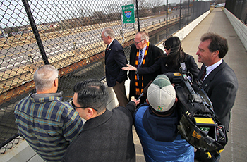 State and local lawmakers tour the existing County Road 9 bridge over I-494 as part of the city's advocacy efforts