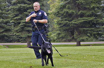 Plymouty Police Officer Steve Larson with K9 Knight