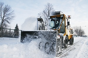 City of Plymouth plowing trails and sidewalks
