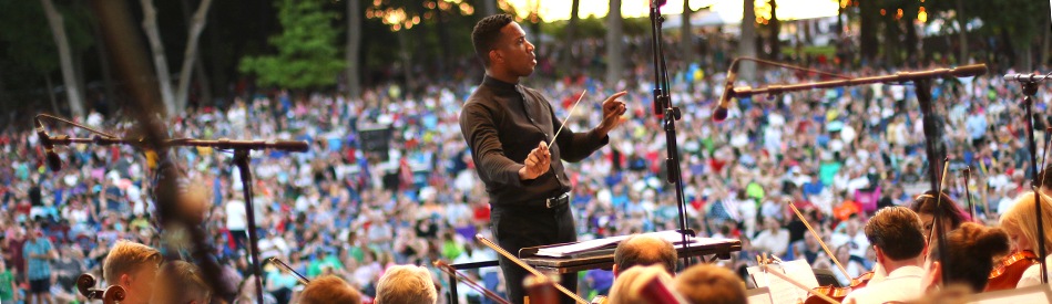 Conductor leading the Minnesota Orchestra performing at Music in Plymouth