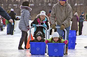 Recycling bin races on the frozen lake at Fire and Ice in Plymouth