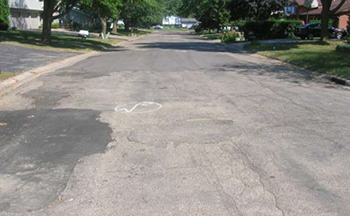 A street in poor condition before the project