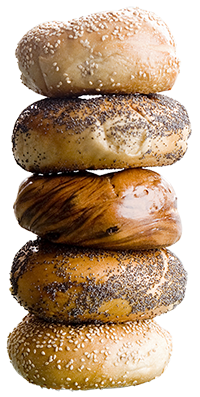 Sesame, poppy seed and cinnamon bagels stacked vertically on each other