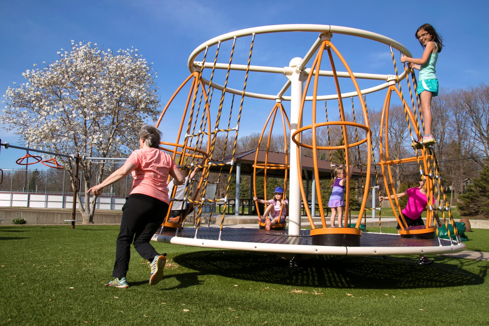Children playing on playground equipment at Plymouth Creek Park