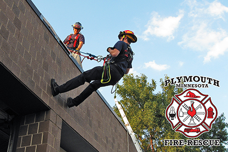 Plymouth firefighters repel training on the side of a building