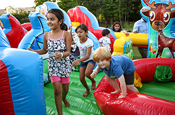Kids playing on inflatables at Kids Fest