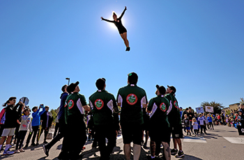 Gymnastics team doing tricks during Plymouth on Parade