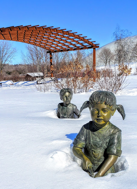 """When we were young, we walked to school through the Millennium Garden in three feet of snow, without hats, coats or mittens!"" by Ann Koktan"