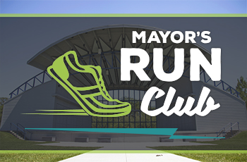 Sunny day at the Hilde Performance Center amphitheater, featuring the Mayor's Run Club graphic